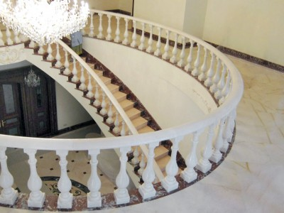 white marble staircase and marble floors